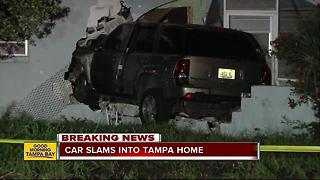 Texting teen plows SUV through wall of Tampa home - Video