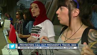 Protesters rally against Trump's travel ban at Tampa International airport - Video