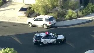 Police search for suspect in car theft near Lake Mead, Rampart - Video