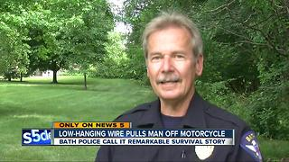 Man pulled off motorcycle by low-hanging wire in Bath Township, police amazed by survival - Video