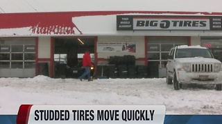 Studded tires move quickly in tire stores in snowstorm - Video