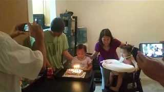 Young Birthday Girl Gets Help Blowing Out Candles - Video