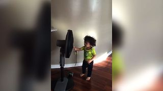 Fan Blows Toddler Away - Video