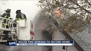 North side house fire spreads to second home
