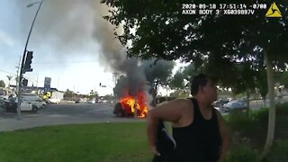 Police officer rescues wheelchair-bound man moments before vehicle ignites