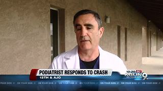 Podiatrist helps rescue motorist during storm - Video