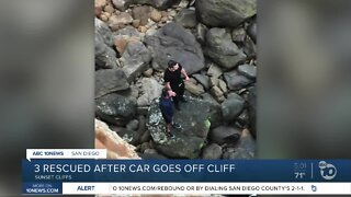 3 rescued after car goes off cliff