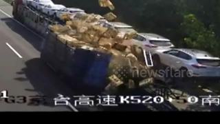 Lorry crash leaves dozens of baskets containing ducks on motorway - Video