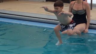 Brother Jumps Into Pool But His Little Sister Tumbles In