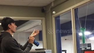 Office workers perfect their ping pong ball throwing skills - Video