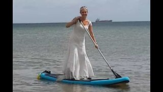 This 54-year-old woman wears her wedding dress every day