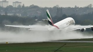 Landing Plane Kicks Up Massive Spray - Video