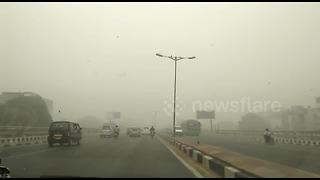 Drive shot through New Delhi street as city chokes under smog - Video