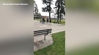 Bakersfield police officer shoots hoops with kids at local park - Video