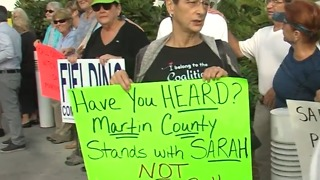 Rally in support of commissioners charged