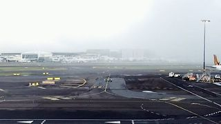 Heavy Morning Fog Blankets Sydney Airport - Video