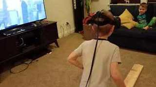 Dad Pushes Kid During VR Game - Video