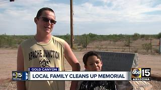 Family cleaning graffiti off historical memorial - Video