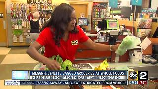 Megan Knight, Lynette Charles bagged groceries at Whole Foods for Casey Cares Foundation - Video