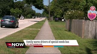 Family posts giant sign to warn drivers of special needs bus that stops at home - Video