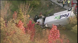 FedEx truck driver trapped, rescued after crash on I-275