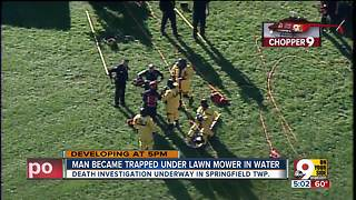 Man dies after becoming trapped under lawn mower - Video