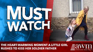 The heart-warming moment a little girl rushes to kiss her soldier father - Video