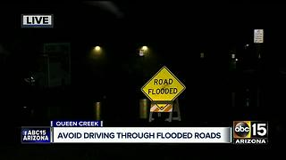 Water floods streets in Queen Creek - Video