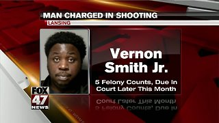 Man charged in Lansing drive-by shooting - Video