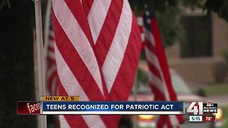Raymore teens pull over to pick up fallen flag - Video
