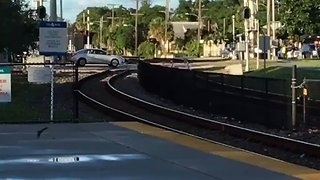 Car Stuck on Tracks in Florida Gets Hit by Oncoming Train - Video