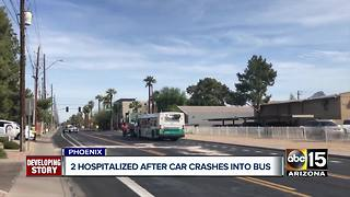 Two hospitalized after car crashes into Phoenix bus - Video