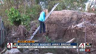 Kansas family stuck after bridge washes away from home - Video