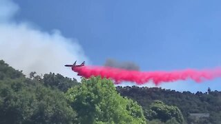 Plane attempts to put out Avila Fire near Pismo Beach, CA