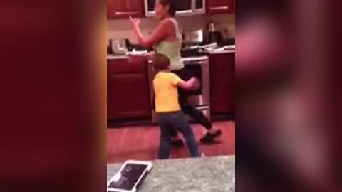 A Woman Knocks Her Son Down With Her Butt