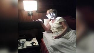 Funny Woman Mistakes A Reading Light With A Room Service Mic - Video