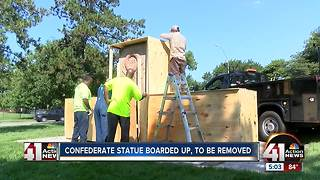 Confederate monument boarded up - Video