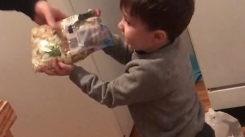 Little Boy Lists The Prices Of All The Groceries