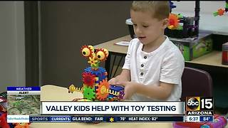 Valley children help with toy testing. - Video