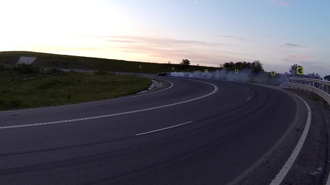 Driver shows off drifting skills on winding road