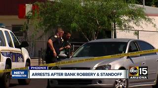 Two bank robbery suspects in custody after hours-long standoff in Phoenix - Video