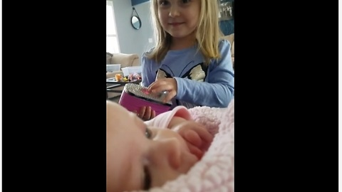 Toddler preciously makes her baby sister laugh