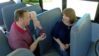 Romantic boyfriend proposes to girlfriend at same school bus stop they first met - Video