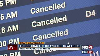 Travelers scramble as snow storm cancels flights - Video