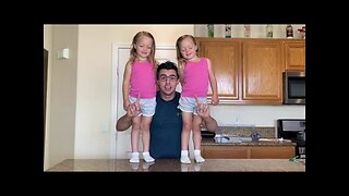 Renato Fernandes exercises with daughters