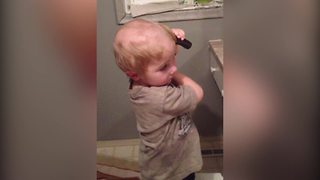 Young Boy Gives Himself A Haircut