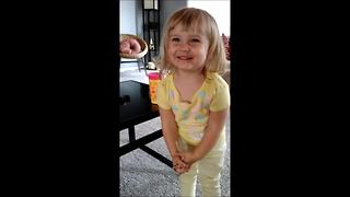 Toddler performs original song, then applauds herself