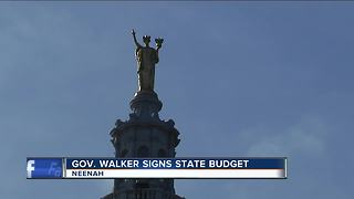 Walker to sign state budget nearly 3 months late - Video