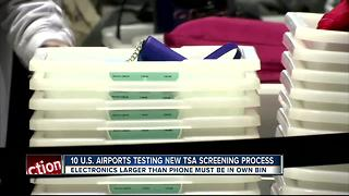 TSA tests screening larger electronic devices separately - Video