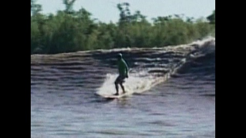 Guys Surf Down Amazon River